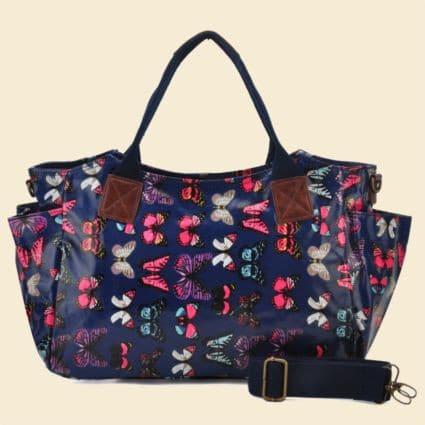 Blå håndtaske - Med sommerfugle
